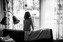 Waiting for a friend (Erik Mattsson) Tags: window waiting girl looking sunlight blackandwhite livingroom room longing anticipating anticipation