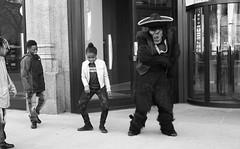 """Dancing with Gorilla Man"" No. 3 - Downtown Chicago - 23 Apr 2017 357 (Andre's Street Photography) Tags: 23apr2017 dancing gorilla man dancingwithgorillaman gorillaman chicago downtown loop michiganavenue kids candid kidsdancing girl streetperformer sombrero street straat straatfotografie streetphotography blackandwhite bw bwphotography zwartwit noiretblanc blancoynegro chicagoist enjoyillinois photobyandrevanvegten canon eos 7dmarkii"