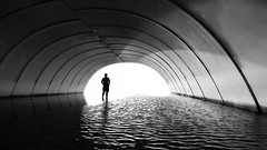 Let Go (Neelima Muneef) Tags: light reflection water monochrome silhouette blackwhite faith uae tunnel ripples leap rak rasalkhaimah