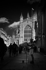 bath abbey and roman soldier bw (Daz Smith) Tags: city shadow portrait people urban bw streets canon blackwhite bath candid guard citylife thecity streetphotography tourists lance armour bathabbey romansoldier canon6d dazsmith bathstreetphotography