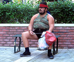 Beggar..Corfu (Don Jackson) Tags: street portrait people man colour male strange hat wall flesh digital canon bench beard army weird arms skin outdoor body character documentary surreal social beggar g12 poweshot