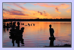 Sunset Silhouettes (bigbrowneyez) Tags: sunset sky ontario canada beautiful clouds reflections river rocks tramonto nuvole gorgeous ottawa silhouettes cielo ripples colourful cognac sculptures breathtaking ottawariver fume bello bellissimo remicrapids sunsetsilhouettes warmgolds infinitexposure rockbalancesculptues