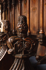 Boston, Lincolnshire, St. Botolph's, choir stalls, finial (groenling) Tags: wood uk greatbritain england boston choir jester bell britain carving lincolnshire gb acrobat chancel fool stalls woodcarving grotesque finial stbotolphs lincs choirstalls bostonstump foolscap