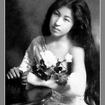 A GEISHA WITH HER HAIR DOWN, HOLDING WHITE ROSES thumbnail