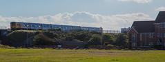 507012 - New Brighton (MoreToJack) Tags: brel class507 merseyrail newbrighton pep railway train wirral wirralline electricmultipleunit emu grass landscape field