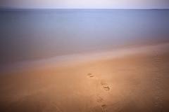 Watery Grave (Photograferry) Tags: ocean longexposure sea beach water coast nationalpark sand waves horizon footprints dorset footsteps studland