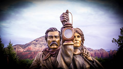 let there be light (lancenesbitt) Tags: life trees red wild arizona woman mountain man mountains building nature statue rock shop bronze clouds train vintage person gold background sony country sedona western lantern northern brass pioneer humans nex nex5