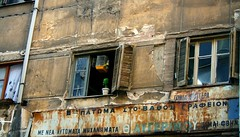 Something small, a touch of color and life and everything changes. * (Teteel) Tags: life windows birds greek greece macedonia shutters basil curtains thessaloniki walls sings timeless cages macedonian  damagedwalls