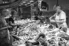 Buying and `Selling Fish (HelenBushe) Tags: select barcelona laboqueria market fishfilleting monochrome bw blackandwhite street candid photography people strangers