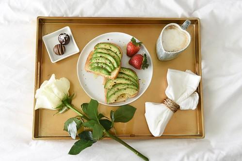 food avocado toast pepper truffles chocolate strawberries breakfast bed mug coffee heart gold