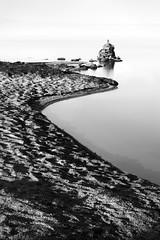 To the Rock Pile (Andrew Hocking Photography) Tags: rocks rockpile colliford reservoir lake water longexposure nd mono blackwhite sand leadin hoya