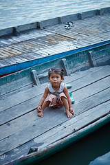 Cambodian little girl, Kompong Chhnang, Cambodia (Alex_Saurel) Tags: portraiture tonlésap halfbody pleinformat photoreportage children girl cambodge people type travel reportage imagetype plantaille fullframe time baby scans horizontal portrait photojournalism portray orientation day photospecs photoreport asia fille stockcategories sony50mmf14sal50f14