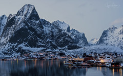 Dusk Time at Reine Village (Jyrki Liikanen) Tags: reine lofoten norway beautiful lights mountain mountains snowylandscape snowyscenery snowymountains village fishingvillage travel travelling holiday dusk evening atmospheric reflection reflections waterreflection stillwater calmsea serenity serene tranquility
