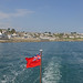 Red Ensign leaving St Mawes