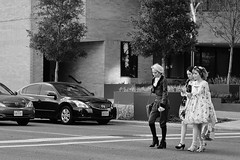 Family Day Cosplay (burnt dirt) Tags: houston texas downtown city town mainstreet street sidewalk streetphotography fujifilm xt1 bw blackandwhite girl woman people person animae cosplay costume uniform matsuri convention asian three mom daughter lolita steampunk walking crosswalk blonde shorthair ponytail boots stripes heels stilettos bag purse phone cellphone trees crowd group discoverygreen georgerbrown