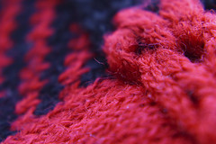 poncho's detail (maotaola) Tags: macromondays clothtextile detail macrophotography diagonals diagonales geometrygeometrie composition abstract red cmwdred texture wool