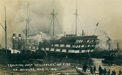 Training Ship 'Wellesley' on fire at North Shields (Tyne & Wear Archives & Museums) Tags: postcard northshields trainingship wellesley fire vessel rivertyne tyneside northeastengland industrialschool tugs maritimeheritage industrialheritage industry shipbuildingheritage blackandwhitephotograph archives digitalimage fascinating interesting unusual postcards 11march1914 blaze destituteboys glimpse insight view shields northeastofengland unitedkingdom grain mark smoke blur sky mast rope pole flag deck rail transportation window structure construction chimney vent oar boat paddle crew wheel porthole cloud water stairs float ship tragedy poignant standing witness hat paddlesteamer paddlewheel steering label letters date year inscription river