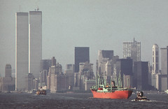 A foggy day on the harbor from the Staten Island Ferry looking toward Lower Manhattan. An orange ship and its tugboat ply the waves. The Twin Towers of the brand new World Trade Center stand tall and proud. New York. June 1974 (wavz13) Tags: oldphotographs oldphotos 1970sphotographs 1970sphotos oldphotography 1970sphotography newyorkphotographs newyorkphotos oldnewyorkphotography oldnewyorkphotos vintagenewyork vintagemanhattan vintagenewyorkphotography vintagenewyorkphotographs vintagenewyorkphotos oldworldtradecenter vintageworldtradecenter twintowers originalworldtradecenter oldbuildings vintagebuildings urbanphotography urbanphotos urbanscenes cityphotography 110film kodacolor analogphotography filmphotography instamatic pocketinstamatic manhattanskyline newyorkskyline newyorkskyscapers 1970smanhattan 1970snewyork oldnewyork oldmanhattan grain grainy vintagephotos vintagephoto oldphoto vintagephotography 1970sphoto