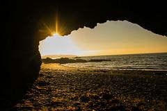 Looking out my back door (A Costigan) Tags: cave caveman sunrise beach irishsea dublin donabate canon eos ireland sunlight light dawn lambayisland water sand