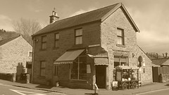 Village grocers, Eyam   -   April 2017 (dave_attrill) Tags: country store shop sepia monochrome eyam derbyshire peak district hope valley 11th century village bubonic plague breakout 1665 rev william mompessom anglo saxon roman lead mining 260 deaths architecture outdoor historic mid 17th cottages cottage april 2017 national park white mines domesday book