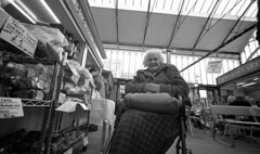 Tasty Scones (4foot2) Tags: candidportrate candid people peoplewatching manchesterpeople interestingpeople wheelchair reportage reportagephotography streetphoto streetshot street streetphotography stockport greatermanchester manchester market food lady analogue film filmphotography 35mm 35mmfilm 1932 1932leica leica111 rangefinder 15mm superwideangle voigtlander15mm voigtlander zonefocus guess shootfromthehip rodinal rolleiretro rolleiretro400s 400s bw blackandwhite 2017 fourfoottwo 4foot2 4foot2photostream 4foot2flickr