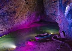 Wookey Hole Underground Lake (john atte kiln) Tags: underground boat rowingboat light lit purple water caves rock rockformations river undergroundriver riveraxe axe wookeyhole wookey somerset england britain uk unitedkingdom limestone cavern chamber