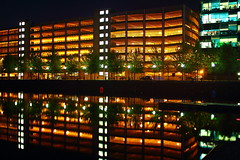 Light Enough? (Idreamofpies) Tags: park lighting uk trees light england urban water car architecture night docks reflections manchester canal ship northwest bright britain great lancashire gb salford quays sodium levels offices