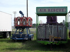 Dreamland Amusements Racked Merry Go Round And Air Rescue Rides. (dccradio) Tags: carnival sky clouds nc northcarolina fair greenery setup lumberton carnivalrides fairrides grasslawn dreamlandamusements rackedcarnivalrides rackedrides robesoncountyfair robesonregionalagriculturalfair