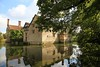Baddesley Clinton, Protected by the Moat (Heaven`s Gate (John)) Tags: blue trees england sky reflection art heritage history water sunshine stone architecture clinton moat nationaltrust warwickshire 10faves baddesley 25faves johndalkin heavensgatejohn