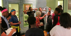 A volunteer docent guides the group