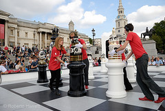 Helpers moving giant chess pieces during a game in Trafalgar Square, London, England. The Tournament, an installation created by Spanish designer, Jaime Hayón consists of a gigantic chess set, with 2m high ceramic pieces designed by Hayón on a specially c (Roberto Herrett) Tags: uk england people game london english horizontal set giant moving pieces board chess trafalgarsquare tournament installation british capture popular 2009 stockphoto londondesignfestival jaimehayón rherrettflk chessfederation