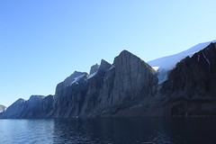 Gibbs Fjord Baffin Island Canada Arctic (eriagn) Tags: travel sea summer canada expedition vertical reflections spectacular landscape waterfall ancient rocks distorted patterns glacier arctic erosion granite inuit northamerica mirrored remote fjord zodiac geology coal habitat volcanic nunavut fiord sedimentary tranquil magnificent fossils stroch sheer stupendous mirroring otherworldly baffinisland weathering topography schist glaciation metamorphic canadianshield gneiss gibbsfjord akademikioffe oneocean naturesabstract eriagn ngairelawson ngairehart 70thanniversaryofthestroch scottinlet