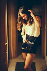 Late function (Sator Arepo) Tags: party portrait home smiling canon happy retrato corridor 85mm indoors purse 5d 12 seek searching elegance markii femininity
