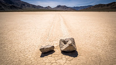 Moving stones in Racetrack - Death Valley, United States - Travel photography (Giuseppe Milo (www.pixael.com)) Tags: photo rock natural landscape ultrawide mountains phenomenon leading rocks california usa unitedstates line travel geotagged deathvalley clouds sky death racetrack photography cliff valley us onsale