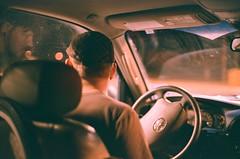 Man in Car (aubreyfantastic) Tags: car man driving twilight dark night nightime 35mm nikon film