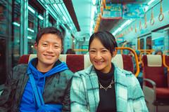 Portrait in Miyajima's Train (Luis Montemayor) Tags: japan japon miyajima couple pareja train tren smile sonrisa