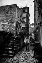 Split, Croatia (pas le matin) Tags: monochrome bw nb noiretblanc blackandwhite world travel voyage split croatia croatie hrvastka city ville urban cityscape man people stairs street candid rue ruelle pavés cobblestone europe europa canon 7d canon7d canoneos7d eos7d