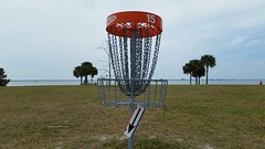Number 16: Down The Rabbit Hole (Michel Curi) Tags: discgolf basket 15 fifteen landscape park picnicisland tampa tampabay grass trees florida lovefl water sky clouds numbers sports outdoors signs arrow pole orange hillsborough target discgolfcourse golf course downtherabbithole