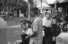 Asking For Direction (Firly Firman) Tags: agfa100 agfaapx100 agfa people pose spotmatic malang pentaxspotmatic streetphotography blackandwhite pancolar 50mmf18 pancolar50mm bnw 35mmfilm filmphotography monochrome mom sister