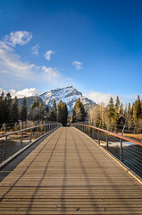 Cascade mountain in Banff National Park seen from bridge in Banff (Mantas Volungevicius) Tags: banff canada alberta national park cascade mountain bridge wood sky clouds sunny spring day nature nikon d7000 travel tourism snow peak river water