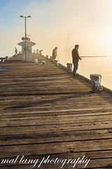 Fishing in the fog (Malcom Lang) Tags: port lincoln southaustralia southern south southernaustralia southerneyrepeninsula southernocean eyrepeninsula eyre lowereyrepenninsula town jetty wood planks bollards lights fog speakers fishermen fishing rods shadow sunrise earlymorning buckets hat canoneos6d canon canonef2470mm canon6d canonef light sky australia australian aussie daylight outside outdoor outdoors recreation mal lang photography
