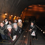 Students posing for a photo on an escalator