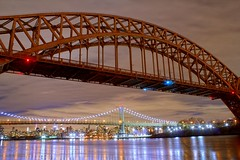 The arches here were built 'cause they don't fall... (Rommel Parada) Tags: hellgatebridge astoriaqueens nyc ny newyorkcity thebigapple robertfkennedybridge nightlights nightshots clouds eastriver metropolis gotham water reflections railroadbridge train amtrak