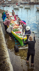 Heave Ho Me Hearties (clive_metcalfe) Tags: boat oars lifting weymouth harbour quay water wheels men women slipway concentration workingtogether hat