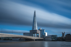 The Shard On Speed, London (SNeequaye) Tags: london england uk unitedkingdom nikon nikon105mmfisheye fisheye riverthames towerbridge theshard canarywharf water still slowshutter slowexposure eastlondon southlondon 122leadenhallbuilding cheesegrater herontower tower42 gherkin 20fenchurchstreet leendgraduatedfilter leefilter neutraldensityfilter nd blackwhite bw black white view thecity thesquaremile skyline londoneye londonbridge southwarkbridge nikond750 tamron tamron2470mm 2470mm millenniumbridge theview southbanktower waterloobridge nikon1635mm 1635mm architecture building cloud clouds