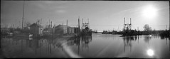 Belford Harbor 7:30 am (thereisnocat) Tags: pinhole pinholeprinted clipper pinholeprintedclipper 6x18 panf50 ilford harbor boats sun water belford middletown monmouthcounty newjersey nj