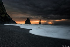 Reynisfjara Beach (DeCastroJr) Tags: column beauty volcanic coastline outdoors ocean hexagonal geological landscape geology pebble beach dramatic reynisfjara nature sky coastal seascape icelandic sea destination nordic winter tourism cave formations beautiful dawn iceland south nobody coast panoramic sunrise reynisdrangar landmark travel vik halsanefhellir shape southern natural pillar panorama basalt