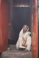 Loneliness (Dewan Imtiaz Rahman) Tags: street streetphotography streetphoto people photography photographer pancake dhaka bangladesh urban age afternoon red white canon canon60d 24mm peopleinthestreet interesting frame loneliness photooftheday streetphotographer photoofday shakharibazar