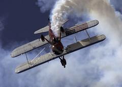 Smoke in the Dive (dcnelson1898) Tags: 2017mcasyumaairshow yuma arizona desert winter mcasyumaairshow planes outdoors gregsheldonairshows 450superstearman biplane wingwalker patriotic aviation