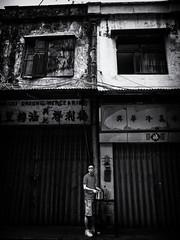 Man with Pot (Feldore) Tags: macau street candid old man pot hongkong traditional shops dilapidated gritty holding saucepan feldore mchugh em1 olympus 1240mm